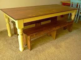 simple diy farmhouse dining table made from reclaimed wood painted with light yellow color and double bench seat on brown rugs ideas