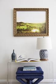 an acrylic console table with an ottoman underneath