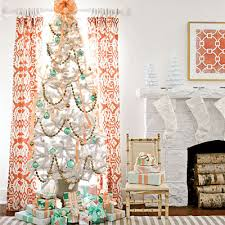 For a more classic look, stick with the deep green tree with deeper orange  and turquoise, plus some neutral colors and textures like this one from BHG   and ...
