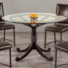 houston round glass dining table by wesley allen shown in a textured cabernet finish