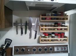 knives and spice racks above stove