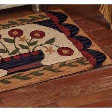 pretty hand hooked rug with fl design
