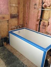 opposite the tub is the toilet and linen cupboards vanity in adjoining room i ve been planning on tiling the area at the head of the bath where sherman