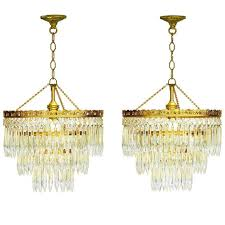 pair of three tiered cut glass and brass drop chandeliers the kairos collective uk
