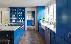 blue cabinets add a pop to white quartz countertops