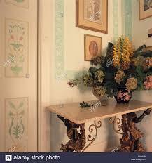 Door Corner Decorations Flower Arrangement On Marble Topped Ornate Gilt Table In Corner Of