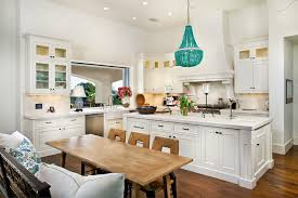 if you have a small kitchen then one larger sized pendant or chandelier would be a nice touch to enhance the small counter space