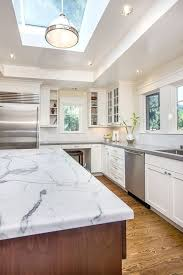 honed quartz countertops kitchen craftsman with glass front cabinets transitional recessed light trims