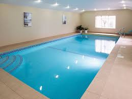 porcelain mosaic tiles and the floor area is laid with non slip porcelain tiles with matching pool edge when not in use the pool is covered by a
