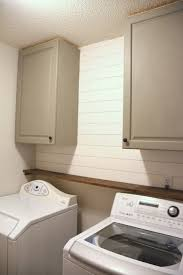 cabinets and shiplap in the laundry