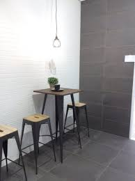 the concrete look combined with subway tile or brick look tile has a clean and