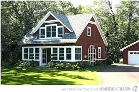 red houses with white trim a farm house trims and gray roof yellow door black shutters
