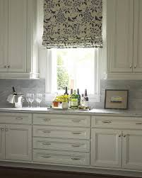 ivory kitchen cabinets with carrera marble countertop and backsplash