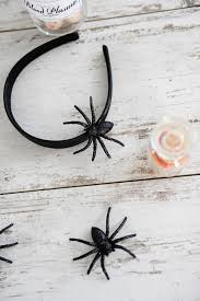 It really is as easy to make as it looks. Simply glue the spiders on to the  headband with the hot glue gun and let sit for a minute or two to ...