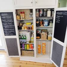 creative chalkboard paint inside kitchen pantry cabinet