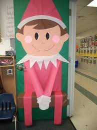christmas office door decorations. for the office elf on shelf door saying above it readshave your christmas decorations