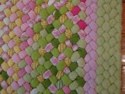 21 x 32 wool oval braided rug hand laced in lime green pink yellow white in hit miss style made with coat weight wool