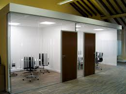 storage and interior concepts have installed a freestanding frameless glass partition in an office lton mowbray coloured striped carpet tiles