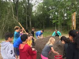 students at falcon ridge elementary school in huffman work to help create the new garden at