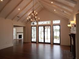 Buttboard ceiling treatment with beams, cathedral ceiling, recessed lighting,  chandelier, Cherokee brick