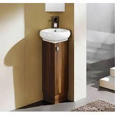 Modern Corner Bathroom Sink With Storage Under Small Mirror On Dark Grey  Bathroom Floor Tiles ...