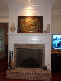 brick raised hearth paneling above mantel