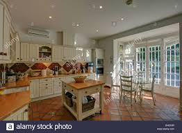Terra Cotta Floor Tile Kitchen Butchers Block In Country Style Spanish Kitchen With Terracotta