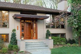 A Homely Splitlevel Gets A Serious Facelift While The Owner Puts - Split level exterior remodel