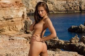 Naked babe posing on the rocks Naked Girls