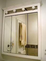 atomic illuminated bathroom mirror cabinet