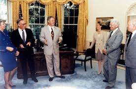 the 1992 enrico fermi award in the oval office are left to right secretary of energy hazel oleary dr john s foster president bill clinton and dr bill clinton oval office