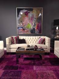 a vibrant purple patterned rug lends a sense of majesty and royalty even when in a modern living room
