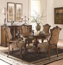The Pemberleigh Round Table Dining Room Collection With - Formal oval dining room sets