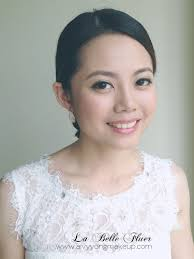 low chignon for elegant cly bridal make up styling