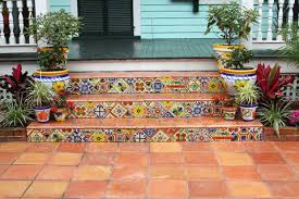 colorful decorative tiles punctuate the saltillo pavers on these front stairs