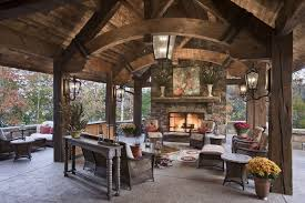 heres another covered patio featuring exposed wood beams and vaulted ceilng over stone flooring brown set patio source outdoor