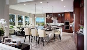 contemporary kitchen with brown cabinets white island and