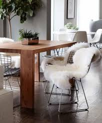 chic and modern in chicago the organic wood blox dining table from pliments the vine bertoia chairs and you really can t go wrong with a well dd