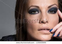 woman wearing heavy eye makeup