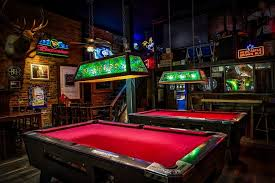 a pool hall using stained glass lighting