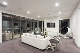 Starkly Modern Living Room With White Walls And Muted Purple Carpet,  Featuring High Contrast Details