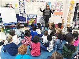 teacher emily silver helps kindergartners at the co op school in bedford stuyvesant