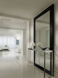 Inspiration for a contemporary white floor hallway remodel in Miami with  white walls