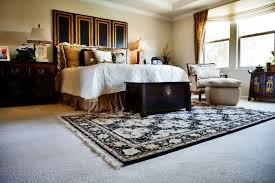 area rug over carpet in bedroom