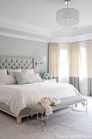 luxe feminine decor and furniture heighten this soft grey bedroom