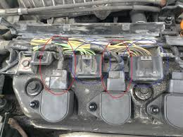 if you have idle issues look here before posting honda civic but is it possible the wires connected to the coils need to be changed either the ones circled in red or the ones circled in blue see picture