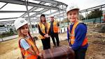 Children bury time capsule under Durham primary school's new classrooms