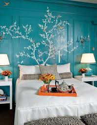 Modern interior design and home decorating ideas, light blue and orange  colors accentuate room decor in white, brown and red colors
