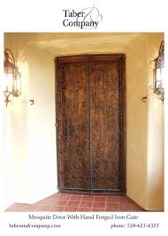 wood doors mediterranean spanish hacienda style forged iron door designed with a solid mesquite entry door taber company custom
