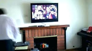 hanging tv over fireplace mounting ideas too high above gas how to mount wall o